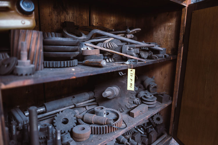 Old machine parts on shelves in industry