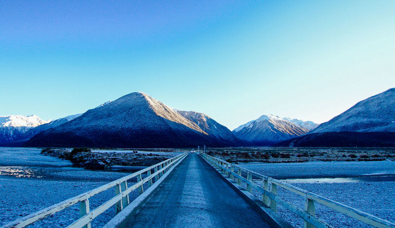 Breathtaking Cold Weather Road Winter Wintertime Working Holiday  Arthur Pass Beauty In Nature Blue Clear Sky Cold Temperature Landscape Mountain Mountain Range Nature New Zealand No People Outdoors Road Road Trip Sky Snow The Way Forward Tranquility Winter Been There.