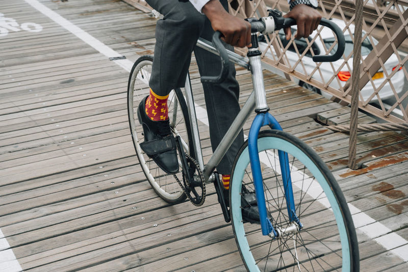 Low section of person riding bicycle