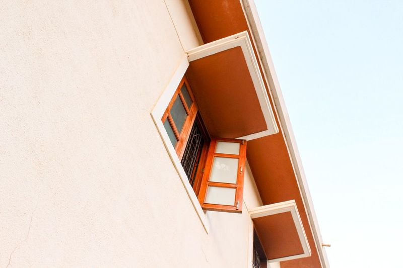 Low angle view of white building against clear sky