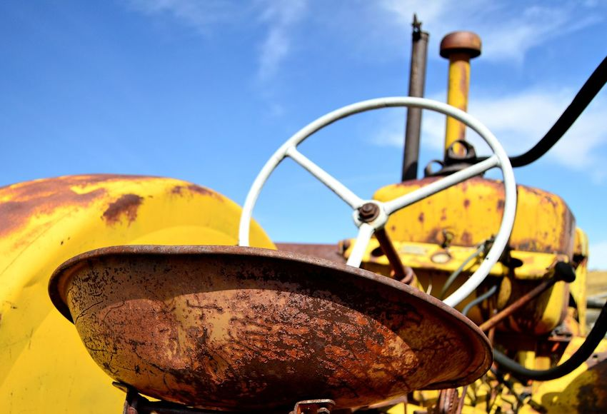 Steering wheel Outdoors Yellow Color North Of Douglas Wyoming Sunshine Shadow Deteriorated Junkyard Rusted Old Weathered Metal Close-up Abandoned Discarded Worn Out