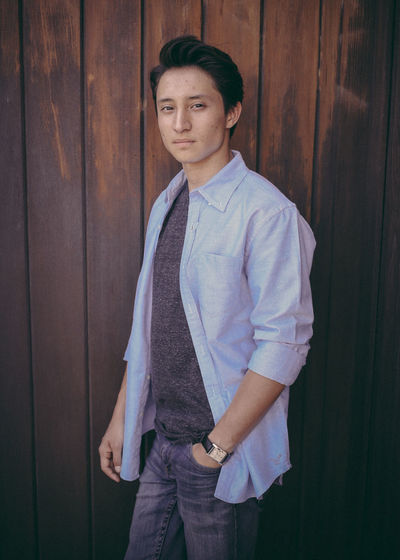 Standing Three Quarter Length One Person Looking At Camera Casual Clothing Young Men Real People Front View Young Adult Portrait Leisure Activity Lifestyles Wood - Material Handsome Day Confidence  Clothing Wall - Building Feature Jeans Fully Unbuttoned Portraiture Portraiturephotography Watch Model Striking
