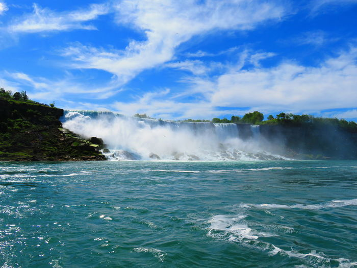 Water Beauty In Nature Scenics - Nature Sea Sky Motion Nature Day Power In Nature No People Cloud - Sky Waterfront Blue Power Outdoors Non-urban Scene Land Travel Destinations Travel Turquoise Colored