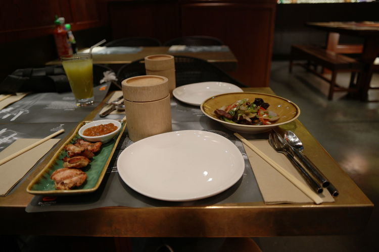 Close-up of served food served on table