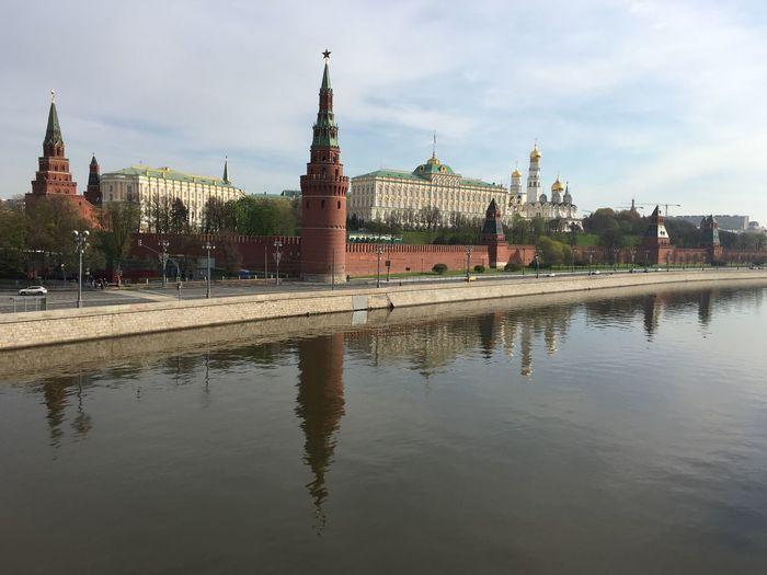 Kremlin by river against sky