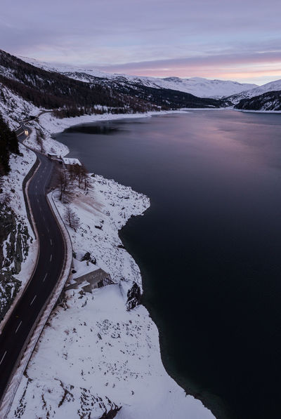 drone view to the lake marmoreara and the moutainroad in the evening Drone  Nature Beauty In Nature Beauty In Nature Cloud - Sky Cold Temperature Day Evening Evening Sky Lake Lake View Landscape Mavic Pro Mountain Mountain Range Nature No People Outdoors Scenics Sky Snow Tranquility Transportation Water Winding Road