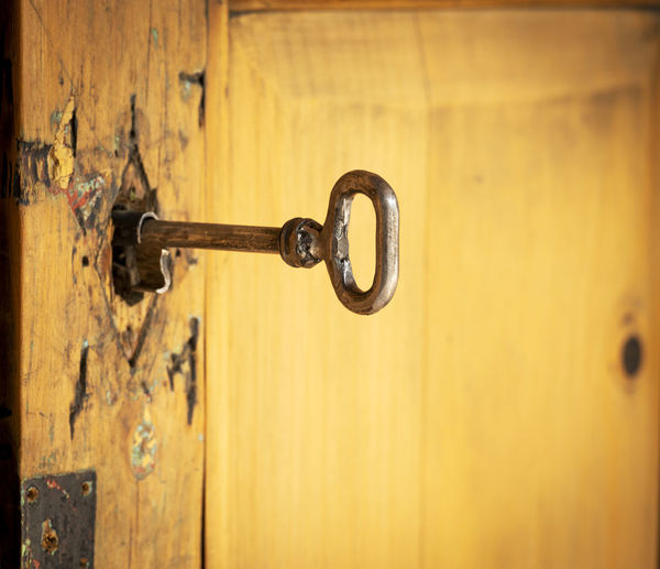 Close-up of key in door hole