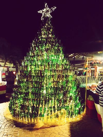 The Culture Of The Holidays Dominican Republic Christmas Tree Christmas Decoration Christmas Lights Illuminated Made Of Wine Bottles Wine Bottles Celebration