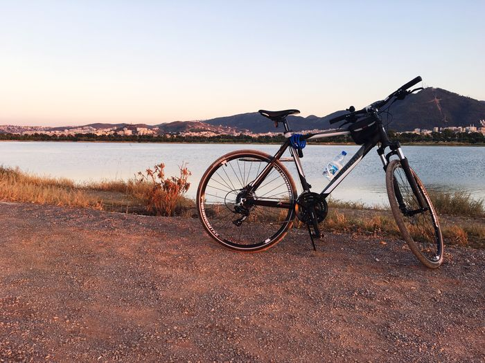 EyeEm Selects Beach Bicycle Transportation Land Vehicle Lake Clear Sky Stationary Mode Of Transport Tranquil Scene Nature Tranquility Outdoors Water No People Wheel Scenics Sunset Landscape Day Sky Beauty In Nature
