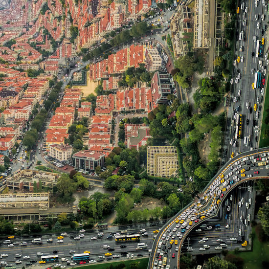 Red alert in istanbul. Year 2010 buildings and traffic jam. Looks like a inception movie effect. Architecture City Transportation Building Exterior Built Structure Mode Of Transportation Road Motor Vehicle Car Street High Angle View Land Vehicle Plant Day Building Tree Residential District Cityscape Nature City Life No People Outdoors Aerial View Istanbul