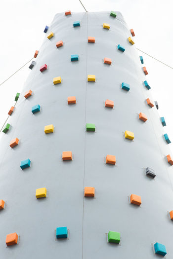 Low angle view of climbing wall against sky
