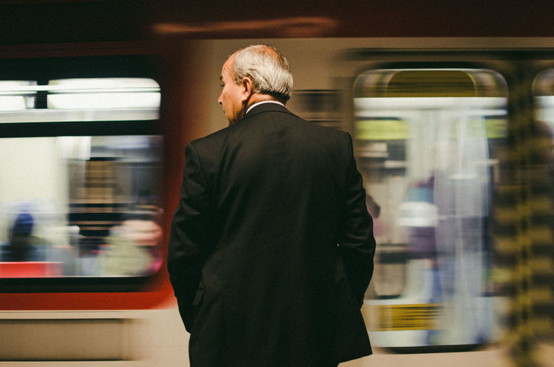 Blured Capture Tomorrow Motion Blurred Motion Mode Of Transportation Transportation Train Rail Transportation Public Transportation Train - Vehicle Men Railroad Station on the move Travel Rear View Suit Passenger Train One Person Well-dressed Business Person Subway Train Streetphotography The Art Of Street Photography The Street Photographer - 2019 EyeEm Awards