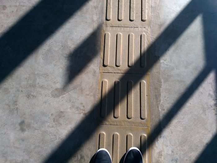High angle view of person shadow on floor