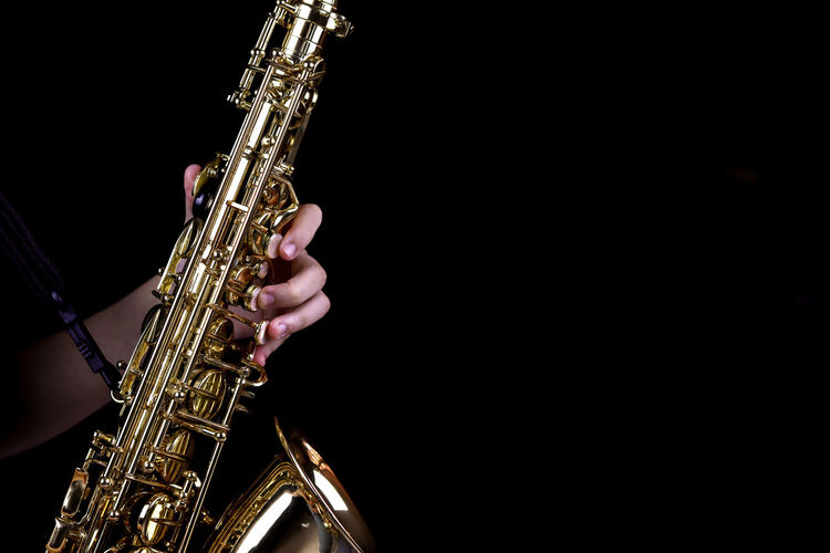 Music Instrument Alto Saxophone Player, Saxophone Player Isolated on black Music Musical Instrument Arts Culture And Entertainment Saxophone Studio Shot Copy Space Gold Colored One Person Artist Human Hand Musician Indoors  Performance Real People Musical Equipment Human Body Part Holding Playing Hand Black Background Finger