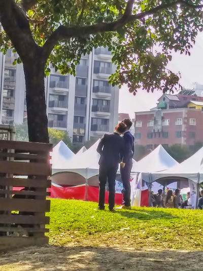 Adult Adults Only Architecture Building Exterior Built Structure City Day Full Length Growth Men Outdoors People Real People Rear View Standing Tree