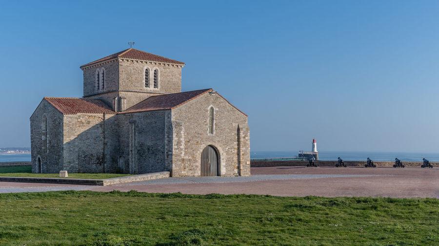Historic building against clear blue sky