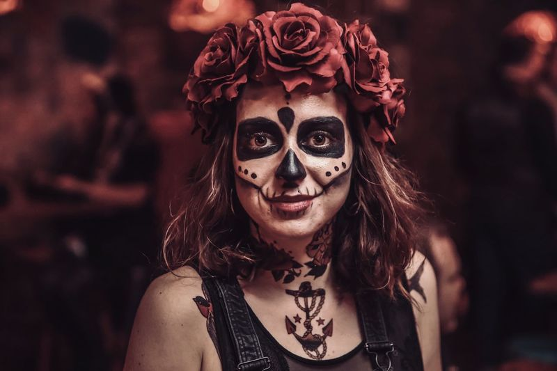 Close-Up Portrait Of Young Woman In Spooky Make-Up During Halloween
