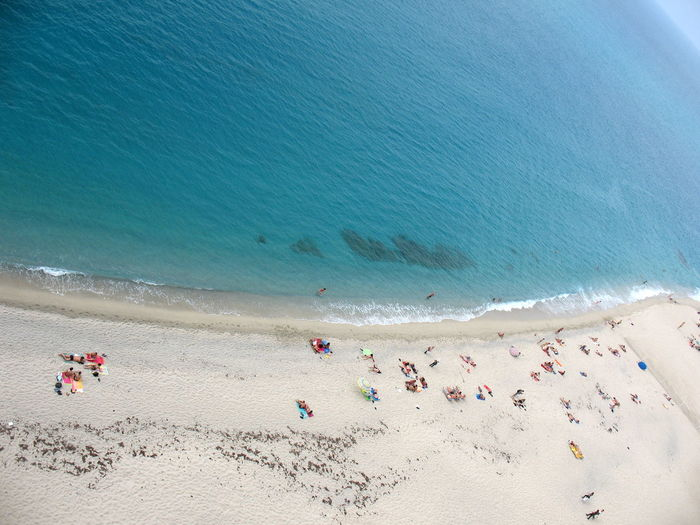 Beach Beauty In Nature Calabria Clear Water High Angle View High Views Horizon Over Water Italy Large Group Of People Mare Nature Person Sabbia Sand Scenics Sea Seaside Shore Spiaggia Summer A Bird's Eye View Color Palette Tropea Vacations Water Sommergefühle