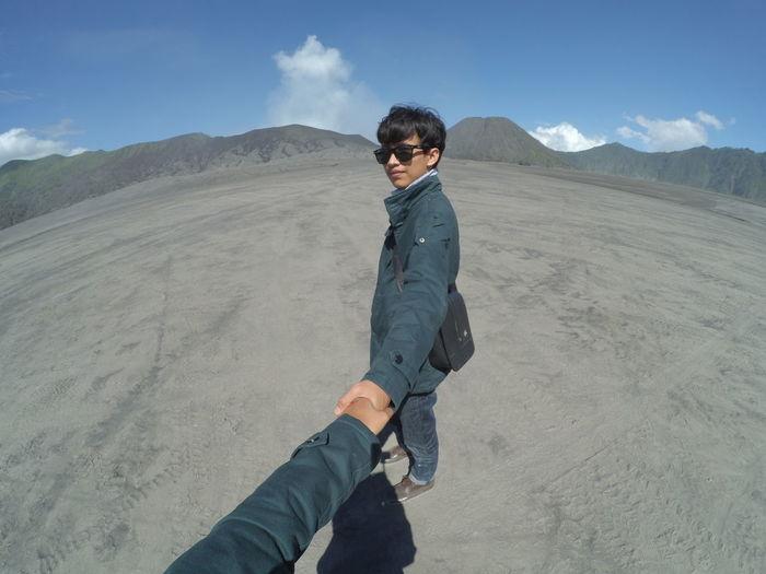 Full length of man on land against sky