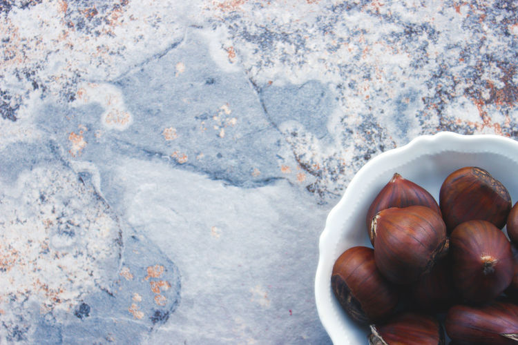 High angle view of chestnuts in bowl on table