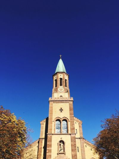 Church Symmetry Autumn Kirche Building Exterior Built Structure Sky Low Angle View Architecture Tower Clear Sky Blue Building Tree Religion Outdoors Nature