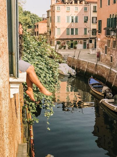 Canal Venice, Italy Venice Building Exterior Built Structure Architecture Water Reflection Nature Transportation Mode Of Transportation Lifestyles One Person Day Residential District Canal Building Real People Motor Vehicle Outdoors City Leisure Activity