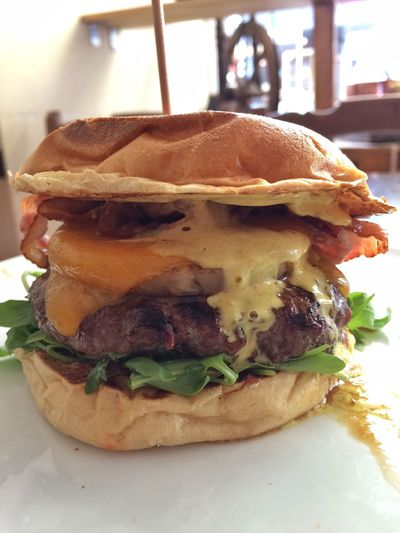 …meet the 'John Wayne Burger '! Beef, Rucola, Pineapple, Cheddar & Bacon. Curry sauce too. #Delicious indeed!