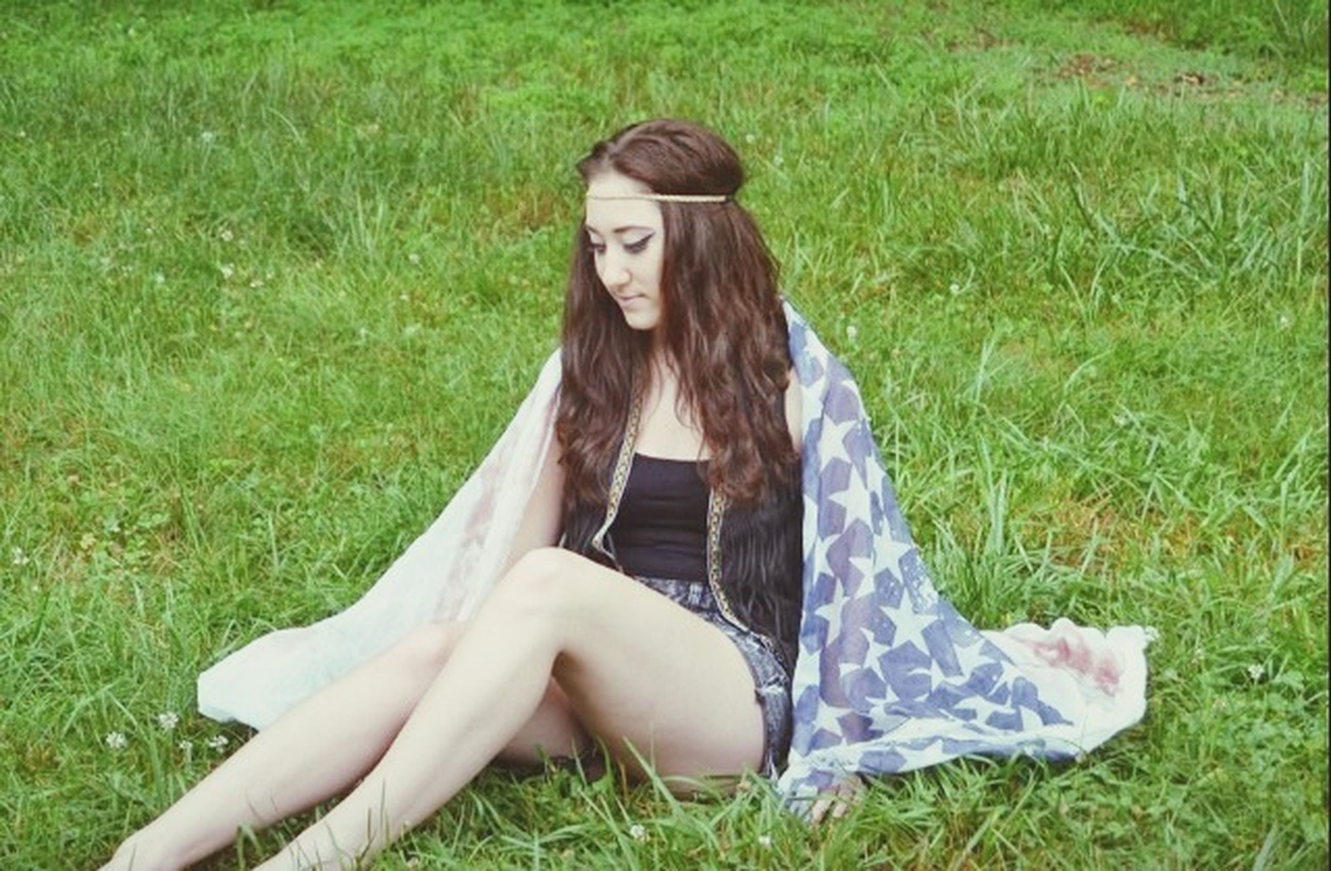 grass, grassy, field, young adult, person, young women, relaxation, lifestyles, casual clothing, leisure activity, sitting, three quarter length, looking at camera, portrait, lying down, full length, front view