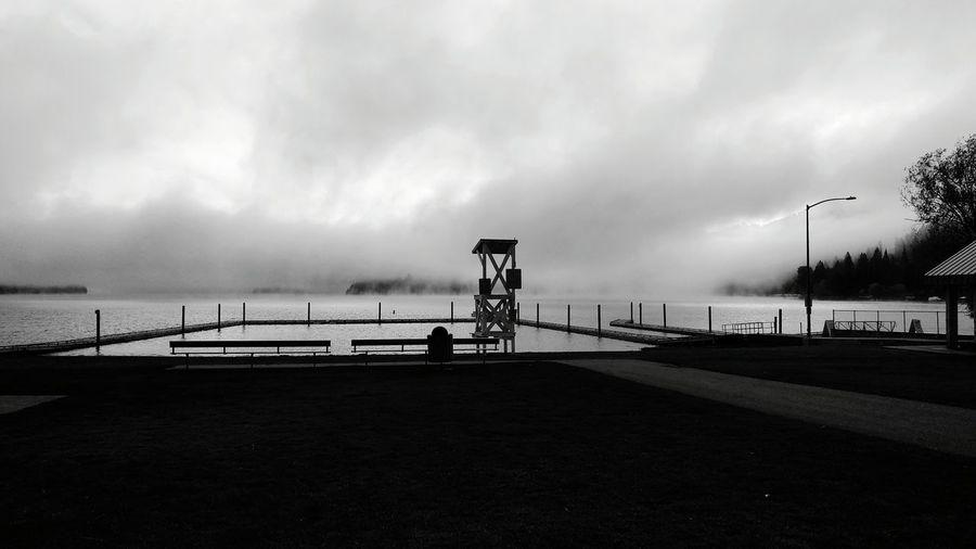View of calm beach against clouds