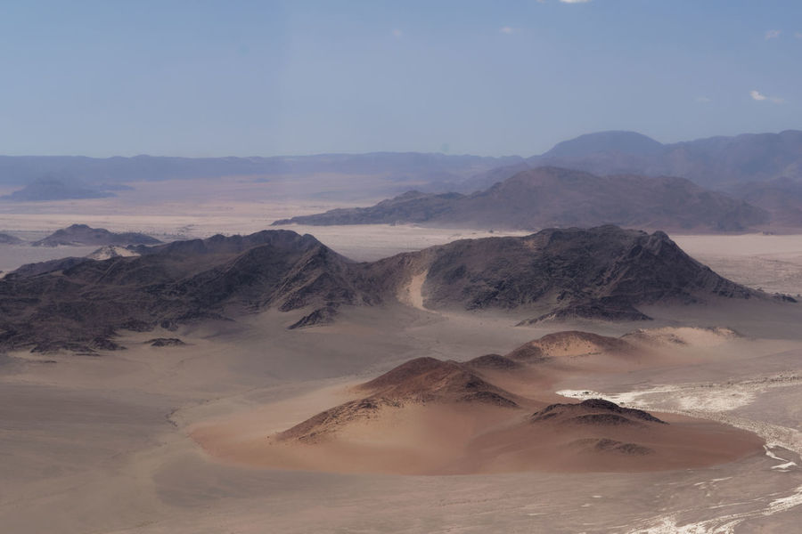 The tranquility of this pure landscape is fascinating Namib Desert Nikon Arid Climate Beauty In Nature Day Desert Landscape Mountain Mountain Range Nature No People Outdoors Physical Geography Sand Dune Scenics Sky Tranquil Scene Tranquility Travel Destinations The Great Outdoors - 2018 EyeEm Awards