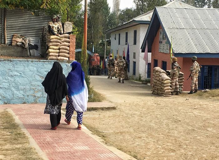 Women coming out of polling booth after casting their ballots in central Kashmir's Budgam district where local civic polls were held on October 8. EyeEmNewHere Gettyimages Polling Station Election Voting Boycott Budgam Kashmir ULB Srinagar  City Tree Full Length Walking Architecture Building Exterior Built Structure