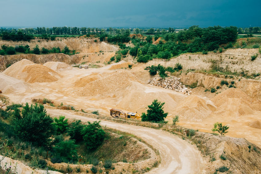 Minerals Climate Desert Environment Geology High Angle View Industry Land Landscape Mine Mining No People Non-urban Scene Outdoors Plant Quarry Road Scenics - Nature Semi-arid Stone Surface Mine Tranquil Scene Transportation Truck Vehicle