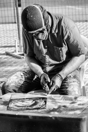 Man creating aerosol spacescapes in downtown Omaha. Spacescapes Street Artist Adult Aerosolart Casual Clothing Day Front View Human Hand Men One Person Real People Sitting Skill  Working The Street Photographer - 2018 EyeEm Awards