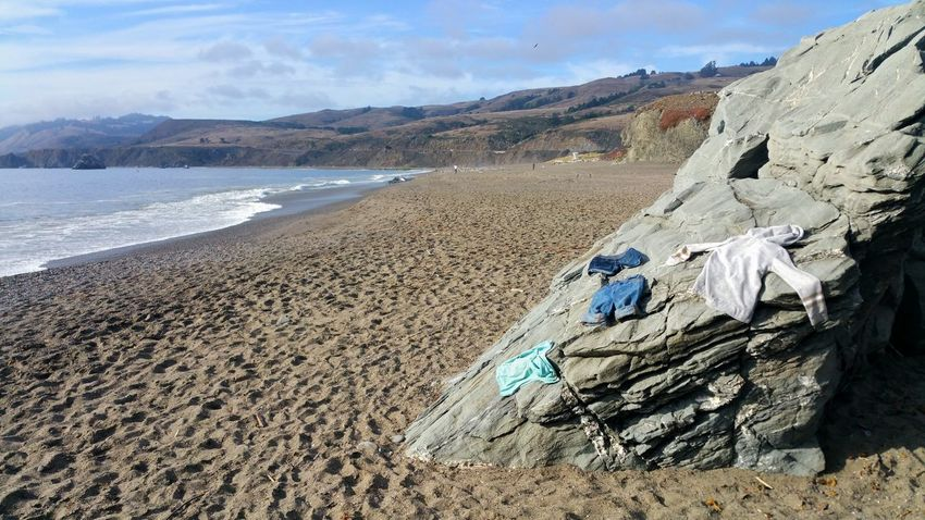 Wet clothes spread put on ocean beach rocks to dry. Day trip! Clothes Wet Drying On Rock Beach Sand Unexpected Swim Ocean Atmospheric Fog Clouds Countryside Day Trip Pants Jeans Hoodie Hoody Shirt Spread Out Fun Sand Dune Beach Mountain Sand Desert Sea Sky Landscape Cloud - Sky Shore