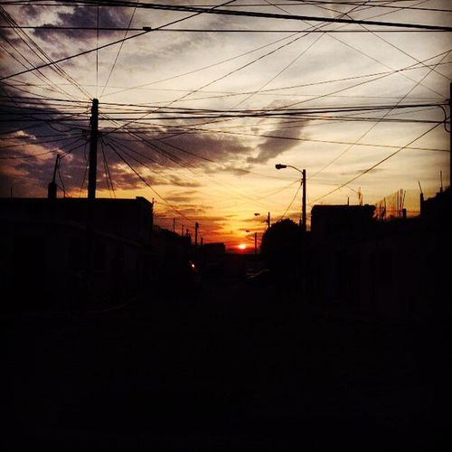 The start that gives us light ... Sun Sunset Perspective VSCO Vscocam GT Clouds Cloud Wire Darksunset House