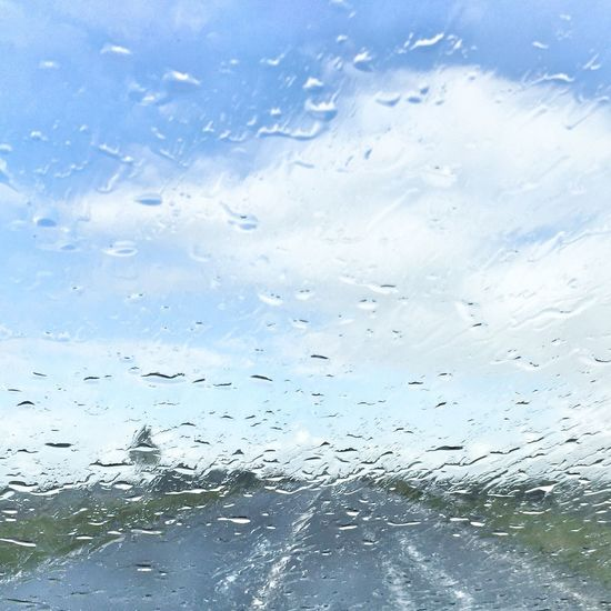 Transparent Window Drop Wet Glass - Material Rain Vehicle Interior Water Weather RainDrop Rainy Season Car Car Interior No People Windshield Sky Backgrounds Looking Through Window Transportation Day