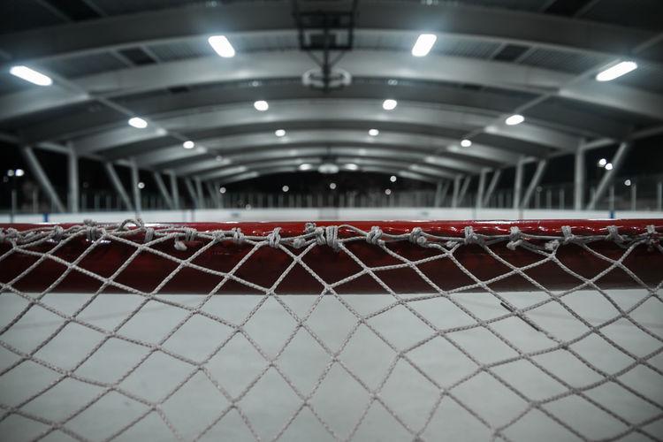 Close-up of hockey net at night