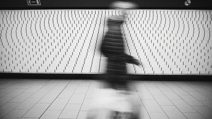 Blurred motion of people walking at subway station