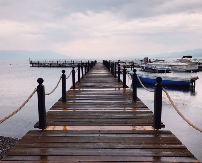 Water Sky Sea Pier The Way Forward Direction Wood - Material Nature Horizon Beauty In Nature Cloud - Sky Outdoors Tranquility