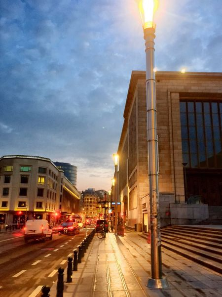 Brussels city around wakey time Architecture Building Exterior Sky Built Structure Cloud - Sky Illuminated Street Land Vehicle City Outdoors Road Street Light Sunset No People Day