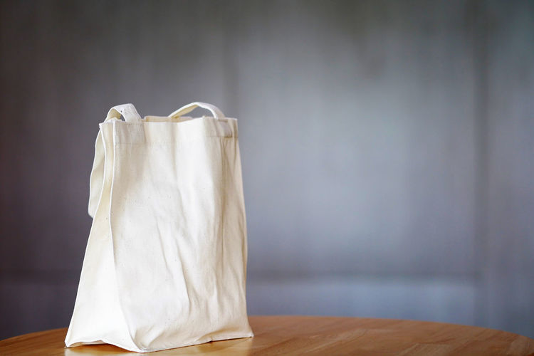 White calico tote bag Eco Absence Bag Blank Clean Close-up Colic Copy Space Empty Environment Fabric Fashion Focus On Foreground Friendship Indoors  No People Simplicity Single Object Still Life Textile Tote Bag White Color