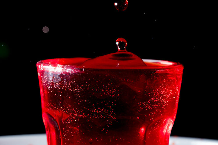 drops of red liquid in glass beaker Abstract Alchemy Alcohol Assets Backdrop Background Banner Bar Beaker Beautiful Beauty Berry Beverage Blob Blood BLOODY Cherry Christmas Close-up Closeup Cocktail Cold Colorful Design Element Dessert Drink Drop Drops Fresh Freshness Fruit Glass Graphic Illustration Jar Juice Juicy Lipstick Liquid Liquidity Liquor Luxury Potion Red Red Background Red Wine Food And Drink Indoors  Refreshment Black Background Household Equipment Studio Shot Food No People Drinking Glass Focus On Foreground Splashing Water Motion Purity High-speed Photography