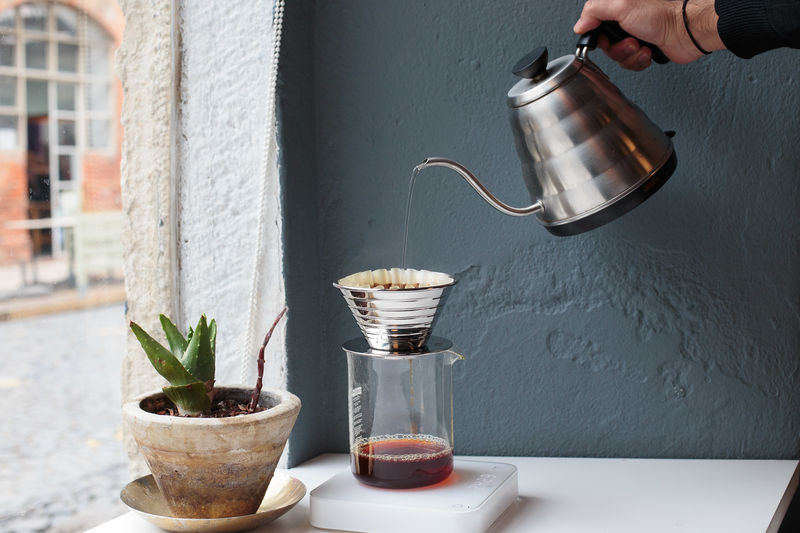 Filter Coffee Architecture Barista Close-up Coffee - Drink Coffee Cup Day Drink Food Food And Drink Freshness Grey Grey Background Grey Wall Human Body Part Human Hand Indoors  One Person People Preparation  Refreshment Table V60 Window