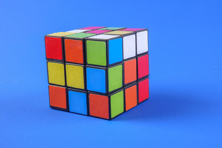 RUBIK'S CUBE , CREATIVITY TOY Creativity Rubik Cube Blue Blue Background Choice Close-up Colored Background Copy Space Cube Shape Design Geometric Shape Indoors  Intelligence Large Group Of Objects Multi Colored No People Rubik Shape Still Life Studio Shot Toy Toy Block Variation