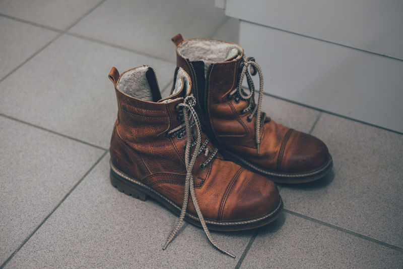 boots Boots Wanderlust Wanderschuhe Brown Boots Brown Shoes Close-up Day High Angle View Indoors  Menswear No People Pair Shoe Shoelace Staywander Things That Go Together Tiled Floor