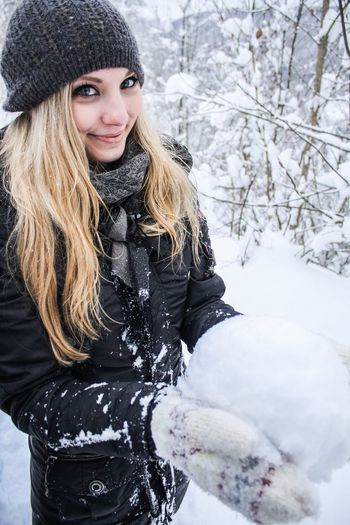 Portrait Of Young Woman Holding Snowball