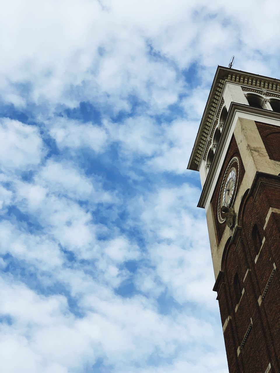 low angle view, cloud - sky, architecture, sky, building exterior, built structure, building, nature, no people, day, tower, clock, belief, clock tower, religion, time, place of worship, spirituality, outdoors