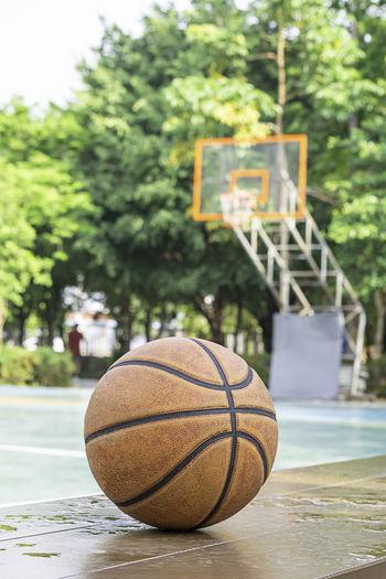 Close-up of basketball ball on retaining wall