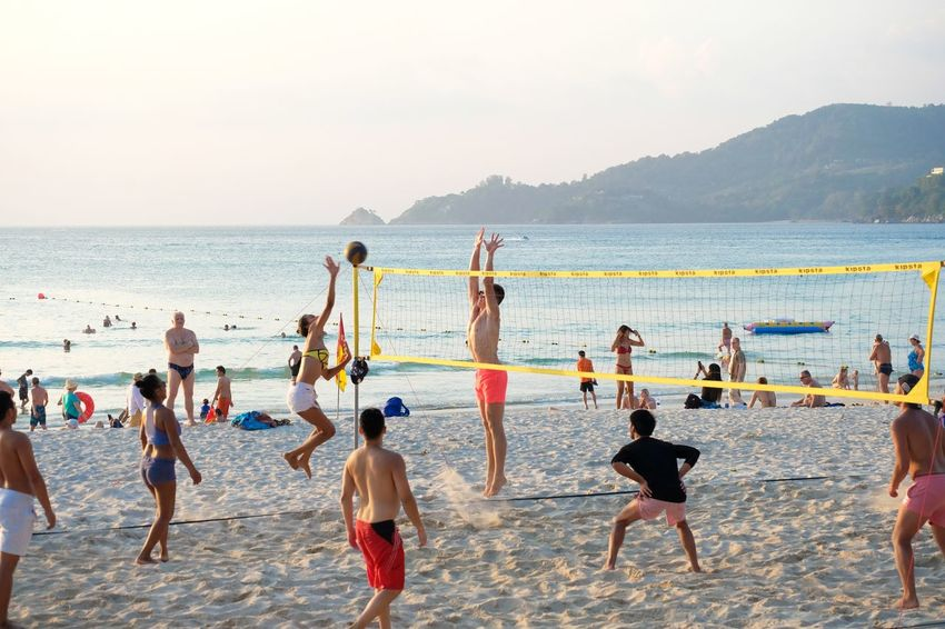 Volleyball beach Volleyball Sea Water Beach Large Group Of People Sky Outdoors Men Leisure Activity Togetherness Competition Real People Day Clear Sky Nature Horizon Over Water Adult Sport Competitive Sport Young Adult People