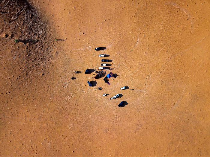 High angle view of people on sand